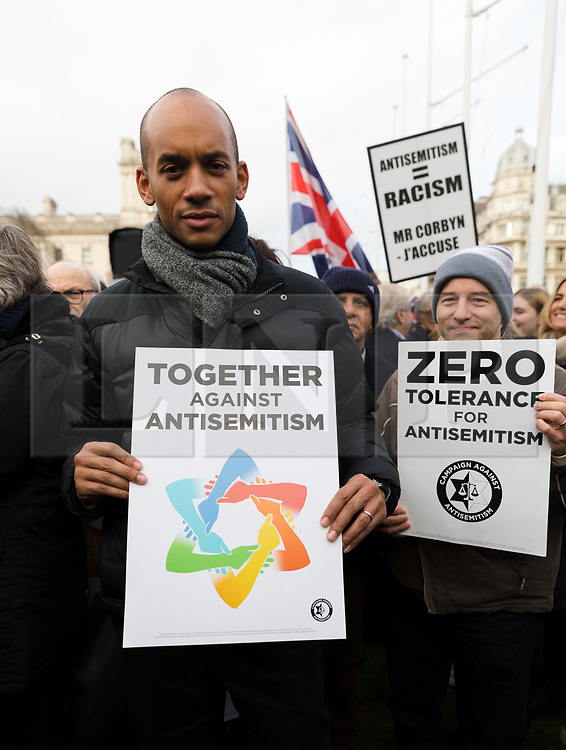 © Licensed to London News Pictures. 08/12/2019. London, UK. Chuka Umunna joins Jewish and non-Jewish supporters from the campaign groups 'Campaign Against Antisemitism' and 'Together Against Antisemitism' take part in a solidarity rally against antisemitism in public life and hate crime, held at Parliament Square in Westminster.  Photo credit: Vickie Flores/LNP
