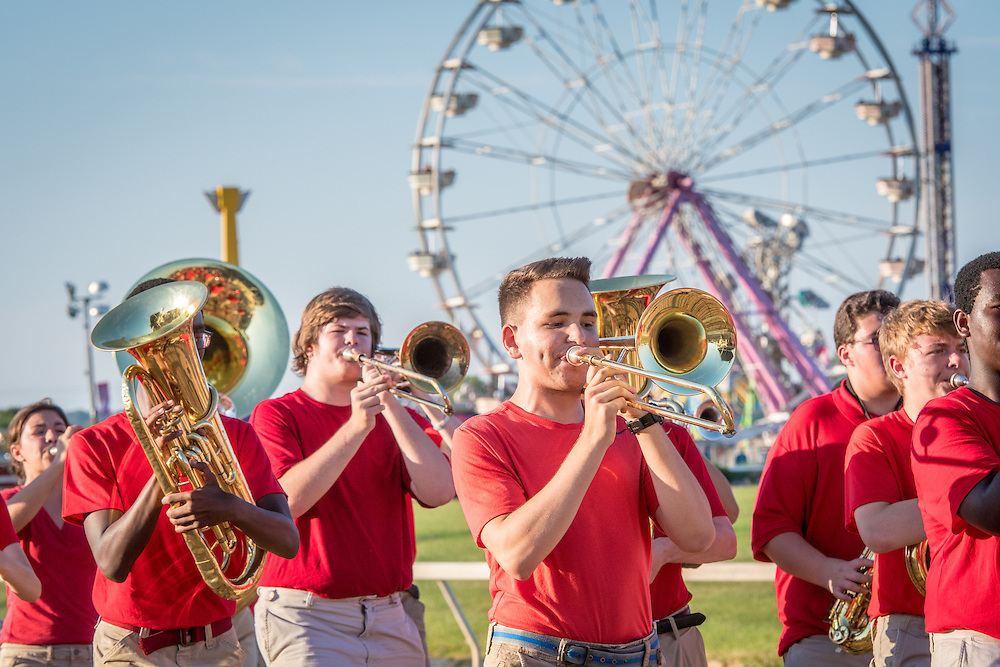 Timonium, Maryland - young men and women playing instruments parade through the fair in a marching band at the 2016 Maryland State Fair.