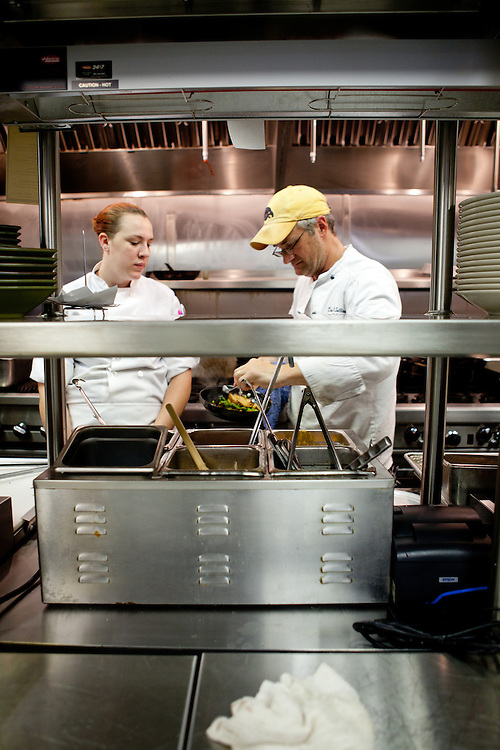 A chef prepares an entree for the dinner rush at The Block Restaurant in Webster Groves in St. Louis with his sous chef.