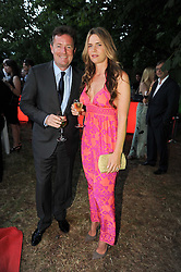 PIERS MORGAN and his wfe CELIA WALDEN at the annual Serpentine Gallery Summer party this year sponsored by Jaguar held at the Serpentine Gallery, Kensington Gardens, London on 8th July 2010.  2010 marks the 40th anniversary of the Serpentine Gallery and the 10th Pavilion.