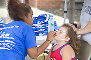 Middletown, New York - Face painting was available at the YMCA Community Fun Day Car Show at the Middletown YMCA on June 2, 2013. The YMCA of Middletown hosted the show in partnership with the Tri-States Car Club and Elks Lodge 1097.ri-States Car Club and Elks Lodge 1097.