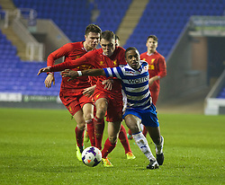 READING, ENGLAND - Wednesday, March 12, 2014: Liverpool's captain Conor Randall and Reading's Tariqe Fosu during the FA Youth Cup Quarter-Final match at the Madejski Stadium. (Pic by David Rawcliffe/Propaganda)