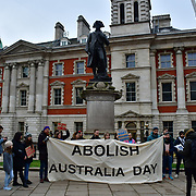 Activists Protest to Abolish Australia Day, to celebrated the invasion of Australia and the cruel brutality against the Aboriginal people continues through this day at Captain Cook statue on 25th January 2020, in London, UK.