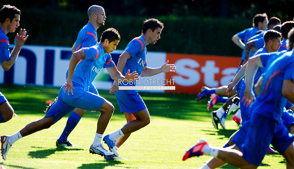 Dutch international football player Robin van Persie , Ron Vlaar , Ibrahim Afellay and Kevin Strootman   during the training for the trainingcamp of the Netherlands national football team in Hoenderloo on May 28, 2012. AFP PHOTO/ ROBIN UTRECHT