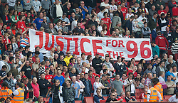 LONDON, ENGLAND - Sunday, April 17, 2011: Liverpool's supporters hold up a banner calling for Justice for the 96 victims of the Hillsborough Stadium Disaster before the Premiership match against Arsenal at the Emirates Stadium. (Photo by David Rawcliffe/Propaganda)