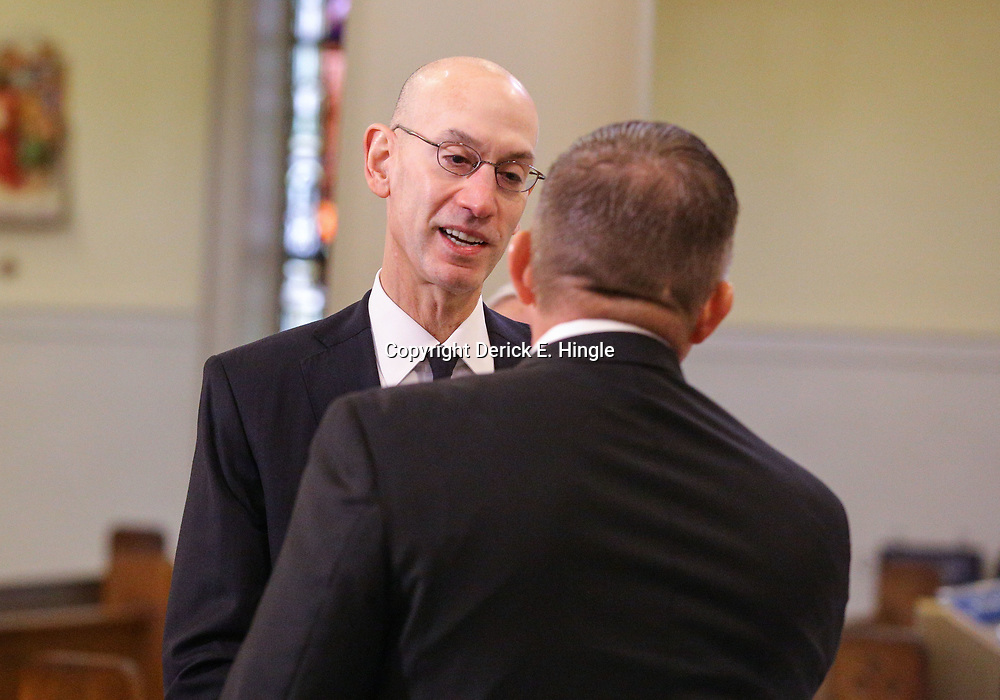 NBA Commissioner Adam Silver greets New Orleans Saints head coach Sean Payton at the funeral service for NFL New Orleans Saints owner and NBA New Orleans Pelicans owner Tom Benson in New Orleans, Friday, March 23, 2018. Benson died last Thursday at the age of 90. (AP Photo/Derick Hingle)