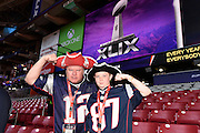 Feb 1, 2015; Glendale, AZ, USA; New England Patriots fans Brian Lescinskas (left) and Luke Lescinskas (right) pose for a photo before Super Bowl XLIX against the Seattle Seahawks at University of Phoenix Stadium. The Patriots defeated the Seahawks 28-24.