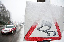 © Licensed to London News Pictures. 13/02/2013. Sheffield, Uk. A road sign covered in snow. There is more snow throughout Sheffield again today. Photo credit : David Mirzoeff/LNP