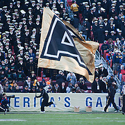 Army cheerleader running across the south end zone after Army quarterback Trent Steelman #8 ran for 34 yards ARMY TOUCHDOWN in the 2nd quarter of the 112th version of this storied rivalry Saturday, Dec. 10, 2011 at Fed EX field in Landover Md.<br /> <br /> Navy set the tone early in the game as Navy defeats Army 31-17 in front of 82,000 at Fed EX Field in Landover Md