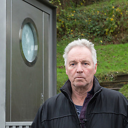 Barry Fowler, whose front entrance to his property is now blighted by the toilet. Local residents are both mystified and annoyed about the sudden appearance of a toilet for bus drivers that has been erected on the corner of Melody Road and Whitby Close in Biggin Hill, Kent. Biggin Hill, Kent, December 06 2018.