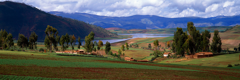 PERU, HIGHLANDS, CUZCO AREA view across traditional village, lake and fields between the towns of Chinchero and Maras