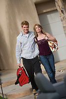 Couple Holding Luggage