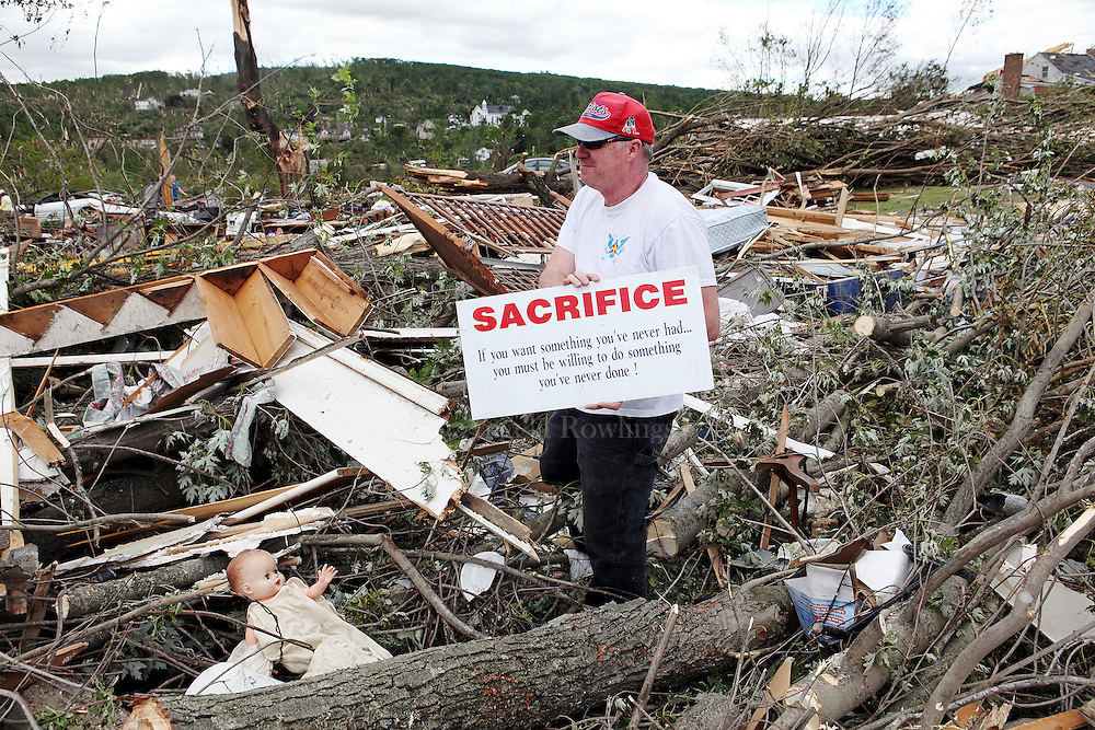 (060211  Monson, MA) Dick Pierce finds a sign in the rubble of his sister Debbie Meacham's Bethany Road home, Thursday,  June 02, 2011.  Staff photo by Angela Rowlings.