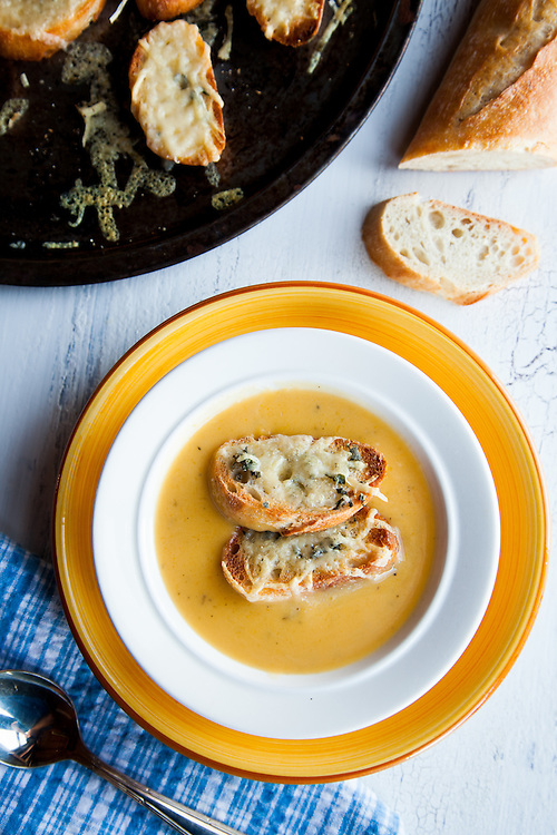 Creamy soup made from acorn and butternut squash, topped with gruyere croutons. Photograph and food styling by St. Louis Photographer Jonathan Gayman.