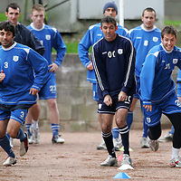 St Johnstone Training...07.11.06<br />Goran Stanic and Paul Lawson battle ina sprint race under the watcful eye of Owen Coyle during training this morning before facing Rangers in tomorrow nights CIS Cup quarter final at Ibrox.<br />see story by Gordon Bannerman Tel: 01738 553978 or 07729 865788<br />Picture by Graeme Hart.<br />Copyright Perthshire Picture Agency<br />Tel: 01738 623350  Mobile: 07990 594431