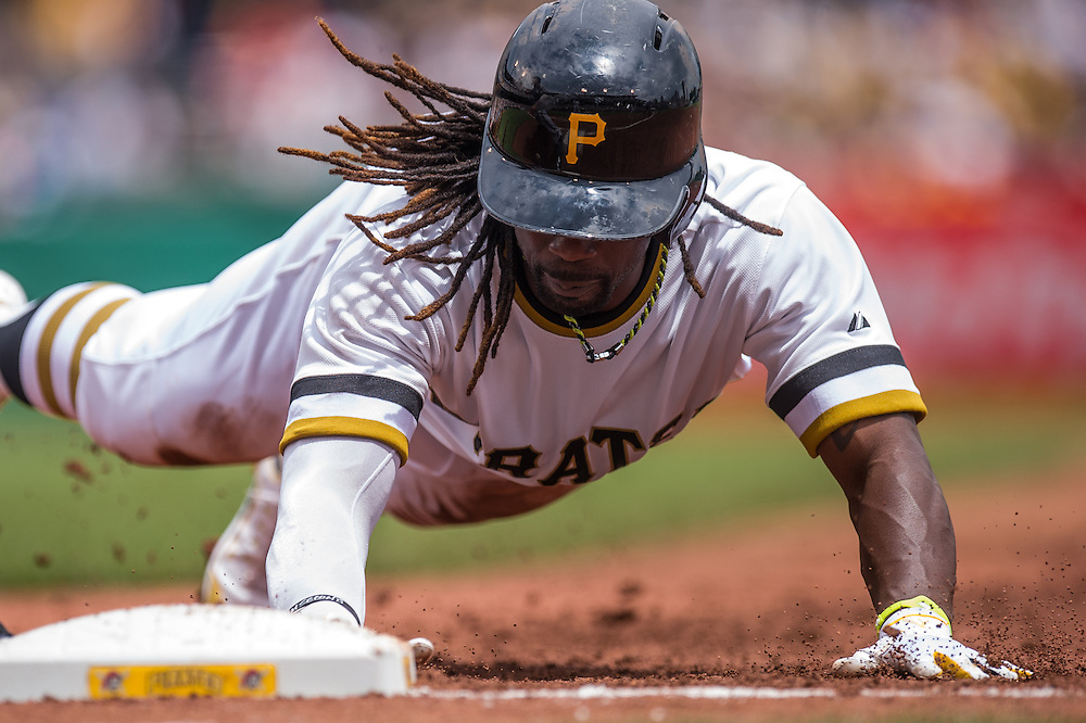 PITTSBURGH, PA - JUNE 08: Andrew McCutchen #22 of the Pittsburgh Pirates slides into 1st base during the game against the Milwaukee Brewers at PNC Park on June 8, 2014 in Pittsburgh, Pennsylvania. (Photo by Rob Tringali) *** Local Caption *** Andrew McCutchen
