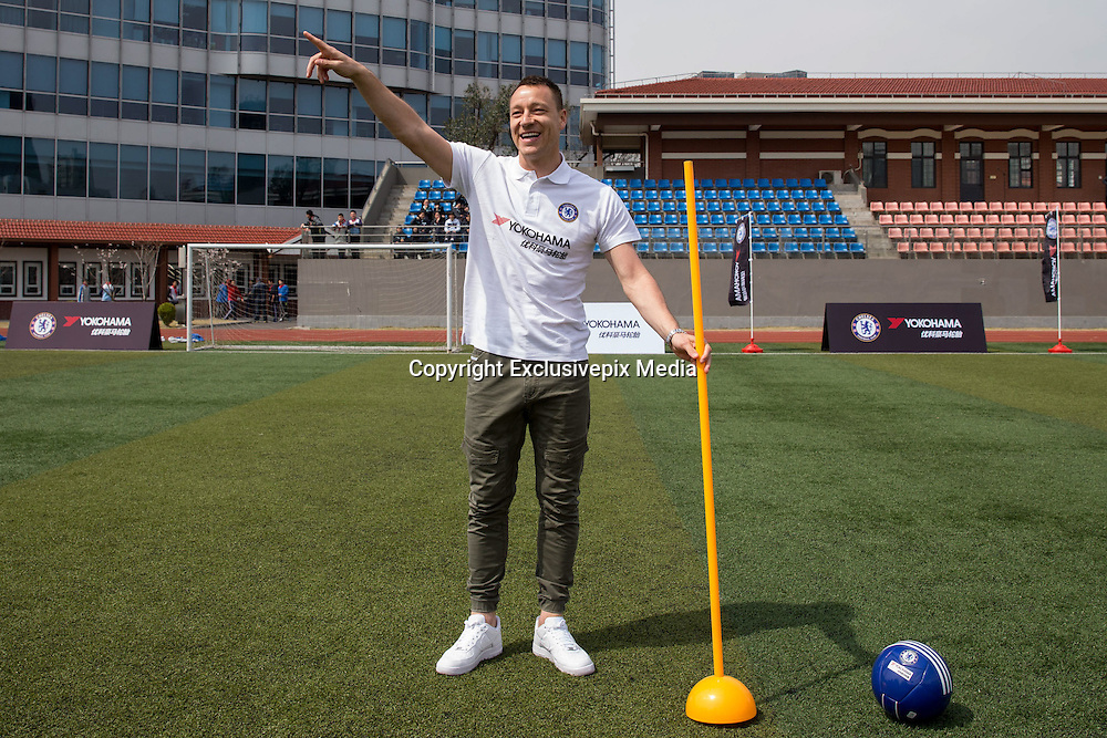 SHANGHAI, CHINA - MARCH 20: (CHINA OUT) <br /> <br /> English professional footballer John Terry plays football to guide students of Nanyang High School as he starts a visit in China on March 21, 2016 in Shanghai, China. <br /> &copy;Exclusivepix Media