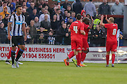 York celebrate Anthony Strakers opening goal during the Pre-Season Friendly match between York City and Newcastle United at Bootham Crescent, York, England on 29 July 2015. Photo by Simon Davies.