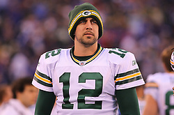 Dec 4, 2011; East Rutherford, NJ, USA; Green Bay Packers quarterback Aaron Rodgers (12) paces the sideline during the first half of their game against the New York Giants at MetLife Stadium.
