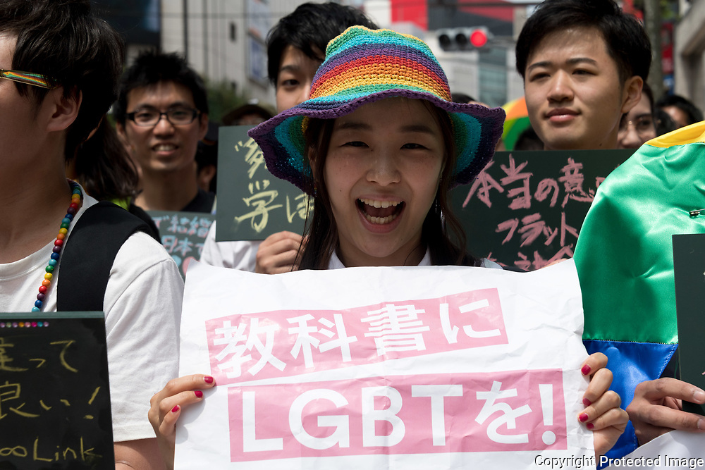 A participant holds a placard to support the LGBT community during the Rainbow Pride parade in Tokyo. Thousands of lesbians, gays, bisexuals, transgenders (LGBT) and their supporters participated in the parade on Sunday to celebrate LGBT lifestyle and denounce prejudice and discrimination against sexual minorities. Amnesty International Japan released a proposal Tuesday May 2, 2017 to the government on measures that the country must take to tackle discrimination against LGBT people: hiding one's sexual orientation or gender identity is still common, due to a fear of losing one's job or facing discrimination, both in the public and the private sector. On health, they asked the government to remove gender identity from the classification of mental diseases, to abolish inappropriate requirements for obtaining legal gender recognition, to educate medical experts, and to set certain health treatments required by transgender people to be covered by the national health insurance and public health systems. 07/05/2017-Tokyo, JAPAN