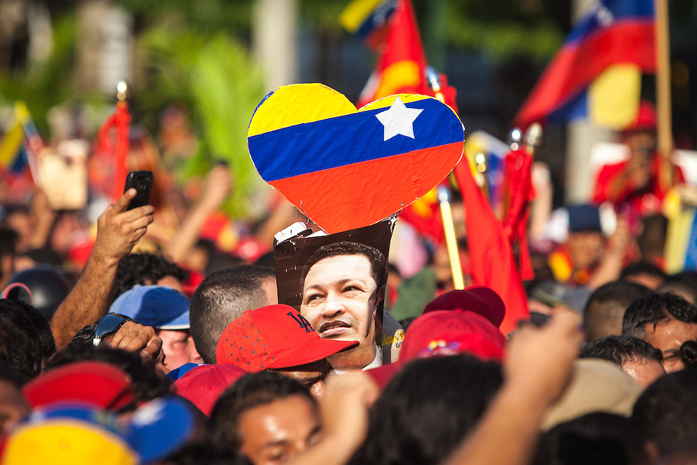 Tens of thousands of Venezuelans gather in the streets of Caracas with the body of the late President Hugo Chavez, who died after battling against cancer at the age of 58. The coffin holding the ex-leader of Venezuela is carried through the streets. Caracas, March. 06, 2013 (Photo / Ivan Gonzalez)