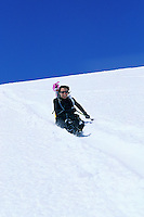 Woman sliding down Muir Snow Field Mt Rainier Washington USA&#xA;<br />