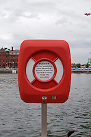 Life saver on the River Liffey Quays in Dublin, sign reads: Please do not vandalise this lifesaving device. It may be needed to save your life someday.