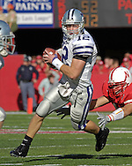 Kansas State quarterback Allan Evridge (12) rushes past a Nebraska defender in the second quarter.  Nebraska defeated Kansas State 27-25 at Memorial Stadium in Lincoln, Nebraska, November 12, 2005.