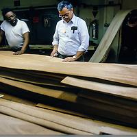 Employees match pieces of laminate at the Steinway Piano factory, Astoria, Queens, New York.