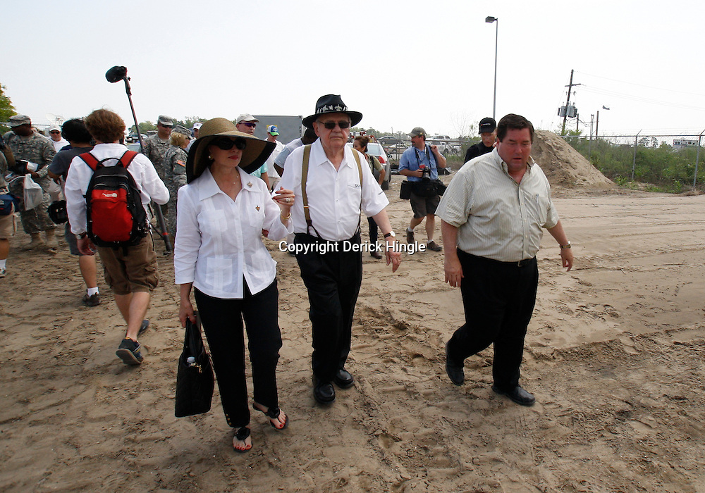 June 8, 2010; Buras, LA, USA; New Orleans Saints owner Tom Benson and his wife Gayle walk with Plaquemines Parish President Billy Nungesser to a bird rehab center stationed at Fort Jackson to clean oil impacted birds. The entire team held a rally at Fort Jackson and visited with members of the small Plaquemines Parish fishing community of Buras that has been impacted by the oil spill. Mandatory Credit: Derick E. Hingle-US PRESSWIRE