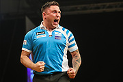 Gerwyn Price celebrates winning the opening leg during the BWIN Grand Slam of Darts at Aldersley Leisure Village, Wolverhampton, United Kingdom on 18 November 2018.