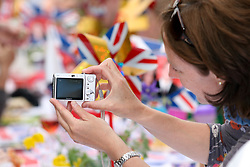 Cambridge, UK  29/04/2011. The Royal Wedding of HRH Prince William to Kate Middleton. Lady taking a photo at a Street Party in Cambridge city centre. Photo credit should read Jason Patel/LNP. Please see special instructions. © under license to London News Pictures