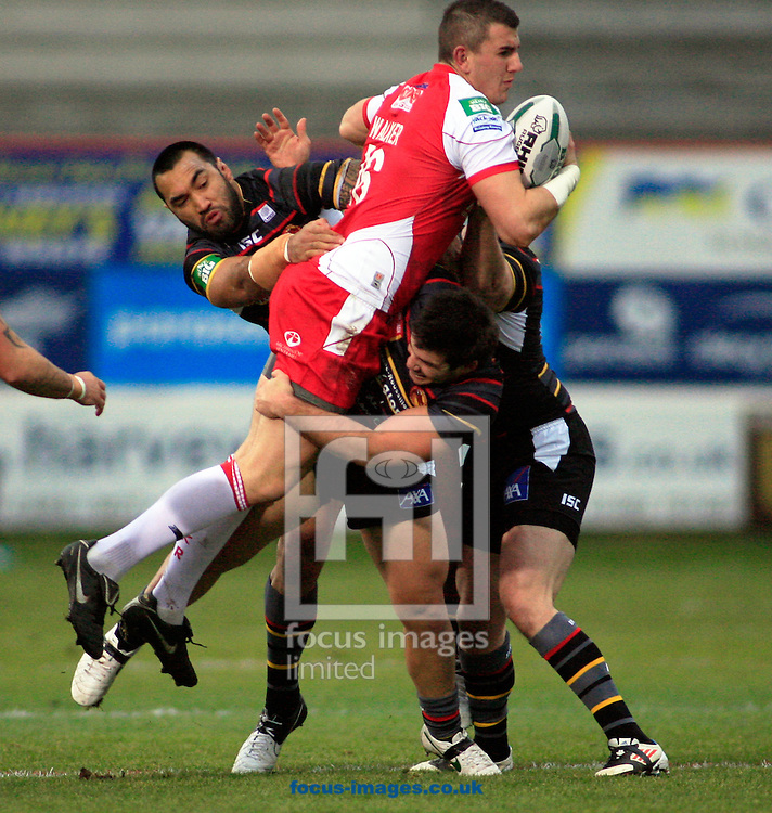 Picture by Richard Gould/Focus Images Ltd +447814 482222.03/02/2013.Adam Walker of Hull Kingston Rovers is stopped by Zeb Taia (left) & Thomas Bosc (right) of Catalans Dragons during the Stobart Super League match at Craven Park, Hull.