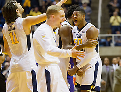 Jan 7, 2017; Morgantown, WV, USA; West Virginia Mountaineers forward Sagaba Konate (50) celebrates late in the second half against the TCU Horned Frogs at WVU Coliseum. Mandatory Credit: Ben Queen-USA TODAY Sports