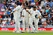 Wicket - Jasprit Bumrah of India celebrates taking the catch to dismiss Moeen Ali of England with Virat Kohli (captain) of India during the first day of the 4th SpecSavers International Test Match 2018 match between England and India at the Ageas Bowl, Southampton, United Kingdom on 30 August 2018.