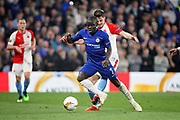 Chelsea FC midfielder N'golo Kante (7) gets fouled by Slavia Prague's Lukáš Masopust (28) during the Europa League quarter-final, leg 2 of 2 match between Chelsea and Slavia Prague at Stamford Bridge, London, England on 18 April 2019.