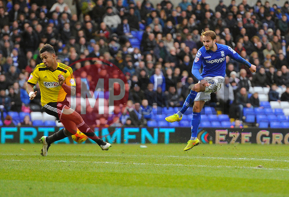 Brentford's Liam Moore blocks the shot of Birmingham City's Andrew Shinnie  - Photo mandatory by-line: Joe Meredith/JMP - Mobile: 07966 386802 - 28/02/2015 - SPORT - Football - Birmingham - ST Andrews Stadium - Birmingham City v Brentford - Sky Bet Championship