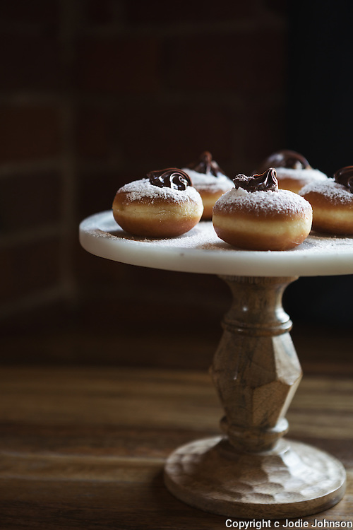 Delicious chocolate topped donuts on a vintage cake stand with space for recipe text