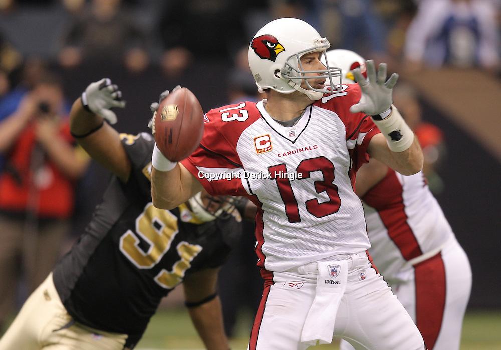 16 January 2010:  Arizona Cardinals quarterback Kurt Warner (13) throws the ball during a 45-14 win by the New Orleans Saints over the Arizona Cardinals in a 2010 NFC Divisional Playoff game at the Louisiana Superdome in New Orleans, Louisiana.
