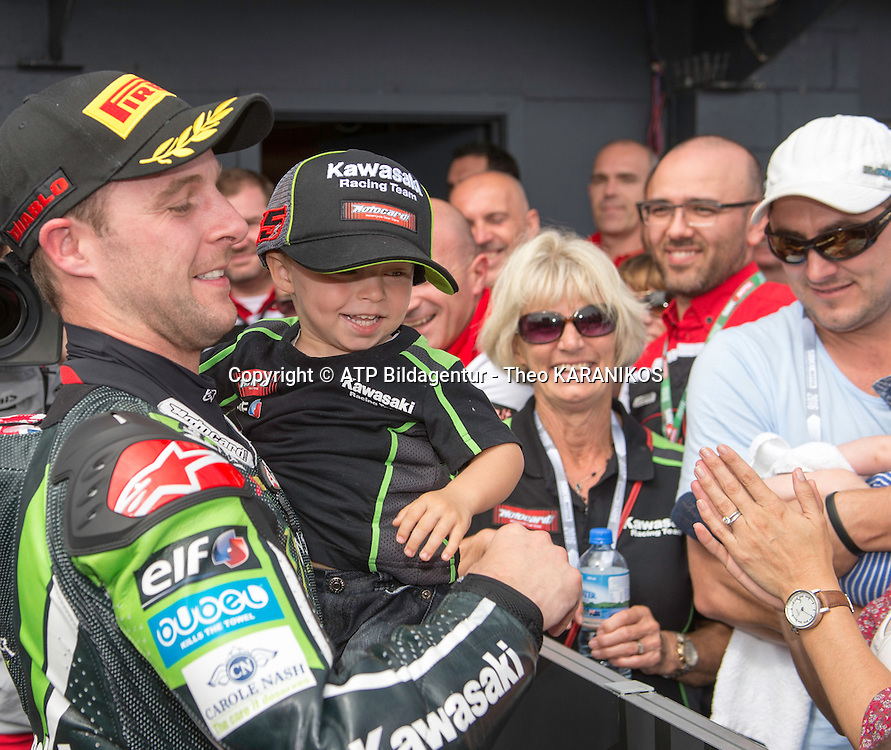 Jonathan Rea (GBR) of Kawasaki Racing Team riding a Kawasaki ZX-10R celebrates with his son after winning race 2 of the first round of the 2016 Superbike World Championship at Phillip Island, Australia.  - fee liable image; photo copyright &copy; ATP  Theo KARANIKOS<br /> <br /> Superbike Weltmeisterschaft in Phillip Island AUSTRALIEN - Saisonstart  2016 - Motorrad - Motorradrennen - Motorradsport - WSBK -