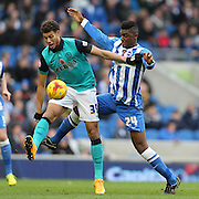 Rudy Gestede (goalscorer) fends off Rohan Ince during the Sky Bet Championship match between Brighton and Hove Albion and Blackburn Rovers at the American Express Community Stadium, Brighton and Hove, England on 8 November 2014.