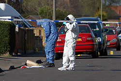 © Licensed to London News Pictures.  01/04/2012. OXFORD, UK. Forensic officers investigate the scene of the fatal stabbing of an 29 year old man in St Martins Road, Rose Hill, Oxford. He died at the JR2 Hospital from a suspected stab wound to the chest. An 18 year old man has been arrested. Photo credit :  Cliff Hide/LNP