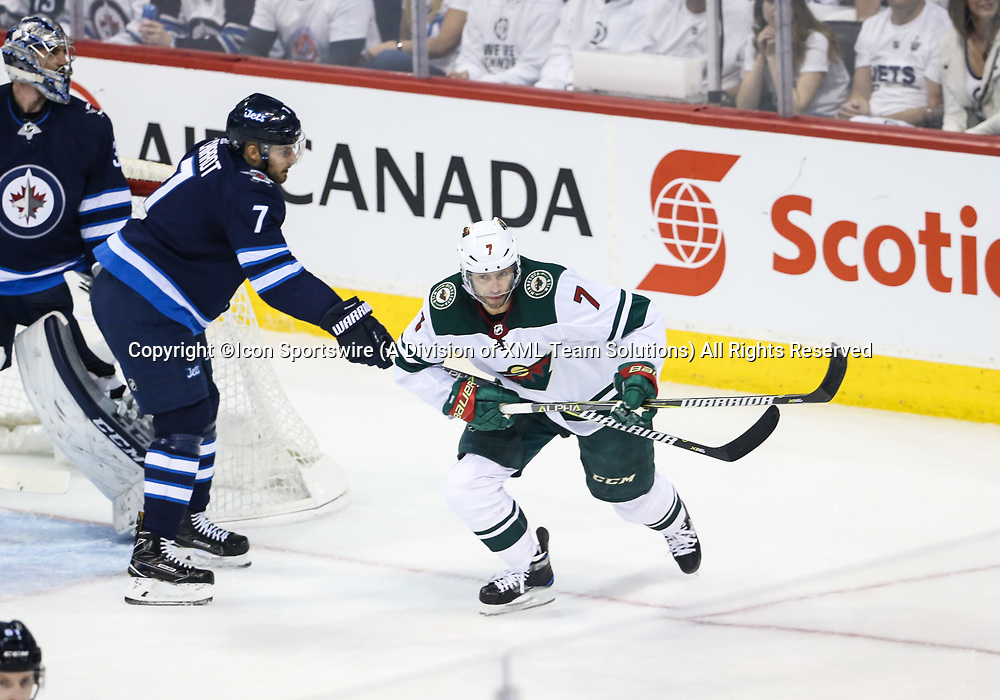 WINNIPEG, MB – April 11: Winnipeg Jets defenseman Ben Chiarot (7) checks Minnesota Wild forward Matt Cullen (7) during the Stanley Cup Playoffs First Round Game 1 between the Winnipeg Jets and the Minnesota Wild on April 11, 2018 at the Bell MTS Place in Winnipeg MB. (Photo by Terrence Lee/Icon Sportswire)