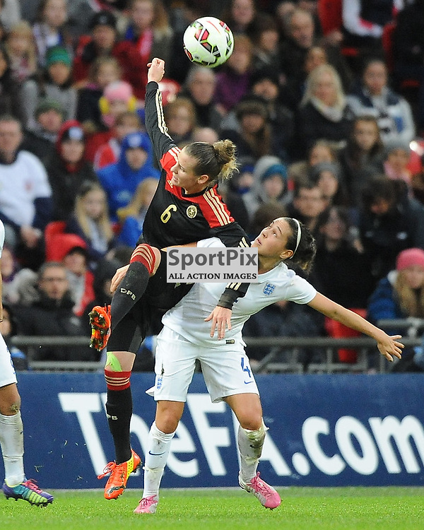 England's Fara Williams holds of Germanys Simone Laudehr, England v Germany Ladies, Breast Cancer Care International, Wembley , Sunday 23rd November 2014