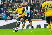 Joelinton (#9) of Newcastle United FC holds the ball up ahead of Sokratis (#5) of Arsenal FC during the Premier League match between Newcastle United and Arsenal at St. James's Park, Newcastle, England on 11 August 2019.