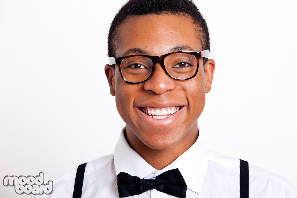 Portrait of young man wearing eyeglasses against white background