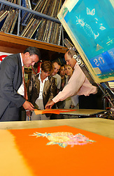 PAARL, SOUTH AFRICA - APRIL-30-2004 - .Marc Verwilghen , Belgian Minister of Development and Cooperation, takes a tour of the Bouckaert - Soenen Textile factory in Paarl, South Africa. The company was started by Belgian natives Mr. and Mrs. Karl Bouckaert in the 1950's and is now run by their son Luc Bouckaert. (PHOTO © JOCK FISTICK)<br />