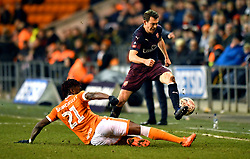 Blackpool's Armand Gnanduillet (left) tackles Arsenal's Stephan Lichtsteiner during the Emirates FA Cup, third round match at Bloomfield Road, Blackpool.