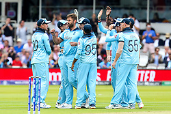 Liam Plunkett of England celebrates with teammates after taking the wicket of Kane Williamson of New Zealand - Mandatory by-line: Robbie Stephenson/JMP - 14/07/2019 - CRICKET - Lords - London, England - England v New Zealand - ICC Cricket World Cup 2019 - Final