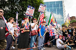 """© Licensed to London News Pictures. 14/07/2018. London, UK. Supporters of US President Donald Trump and EDL founder Tommy Robinson ( real name Stephen Yaxley-Lennon ) hold a """" Welcome Trump """" demonstration opposite the American Embassy . Trump is currently in Scotland and Robinson is in HMP Hull . Photo credit: Joel Goodman/LNP"""